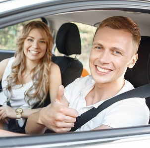 Auto-insurance-girl-and-boy-sitting-in-car